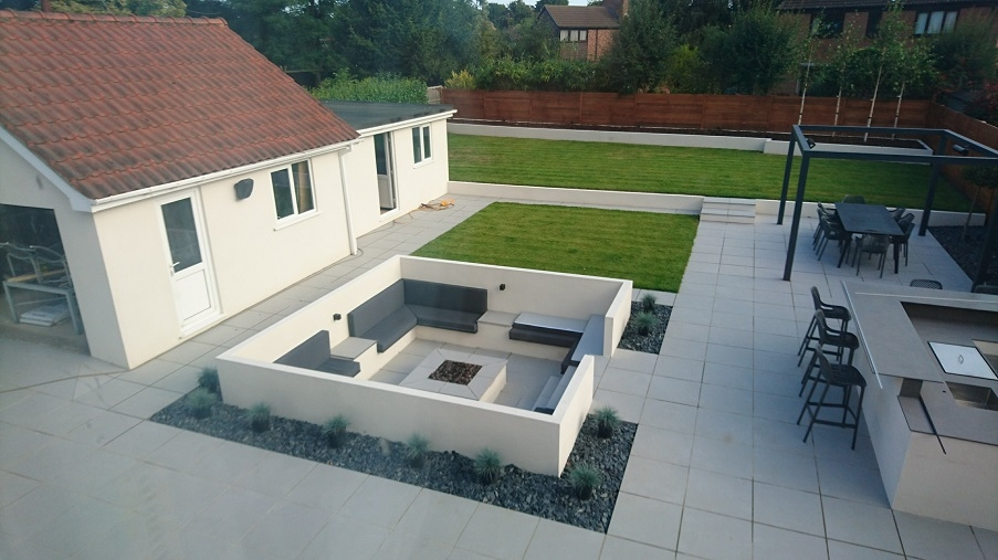 A built-in seating area we installed with a fire pit over the summer.