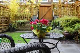 A small garden with a table and chairs