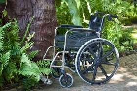 A wheelchair in a wheelchair accessible garden.