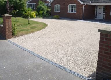Chip driveway with paving drainage